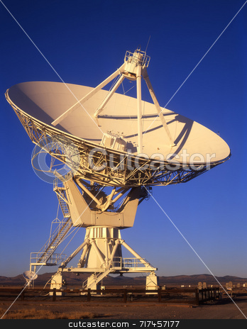 Satellite Dish Daytime stock photo, A radio telescope part of the VLA, Very Large Array, in New Mexico. by Mike Norton