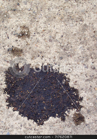 Oil Spot on ground stock photo, Oil spot on concrete driveway leaked from vehicle. by Kathy Piper