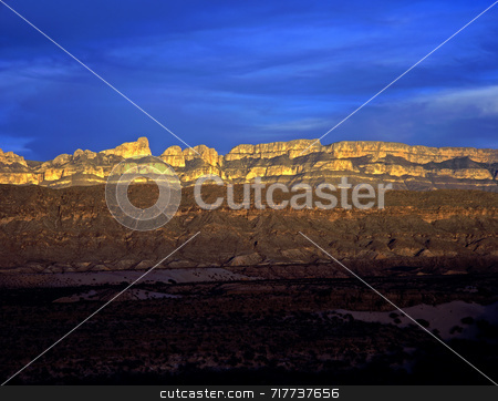 Sierra Del Carmen Sunset stock photo, Sunset on the Sierra Del Carmen, in Mexico, photographed from Big Bend National Park, Texas. by Mike Norton