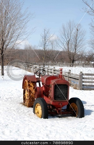 Old Tractor stock photo, A vintage tractor sitting in a snowy field by Maria Bell