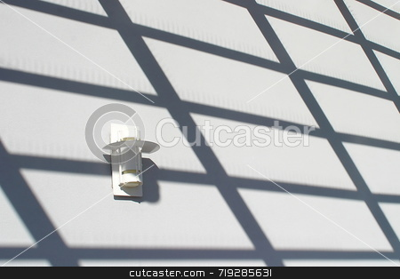 Light And Shadows stock photo, A light on the a wall with shadows that build a design by Henrik Lehnerer