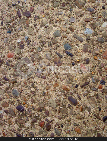 Colorful Pebbles In Concrete stock photo, Colorful pebbles mixed with cement in concrete sidewalk/driveway. by Kathy Piper