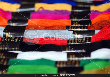 Brightly Coloured Threads stock photo, A selection of brightly coloured embroidery cotton skeins. by Philippa Willitts