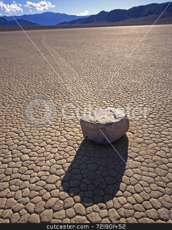 Rock motion stock photo, A rock and its trail on the Racetrack Playa in Death Valley National Park, California. by Mike Norton