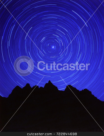 Stars and Mountains stock photo, A circle of stars and silhouetted mountains. by Mike Norton