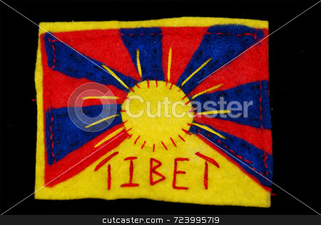 Hand-Embroidered Tibetan Flag stock photo, A Tibetan flag hand-sewn in felt on a black background by Philippa Willitts