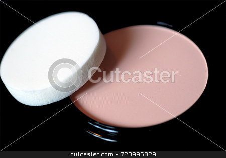 Face Powder and Sponge stock photo, A close-up of a cake of face powder and applicator sponge, on a black background. by Philippa Willitts