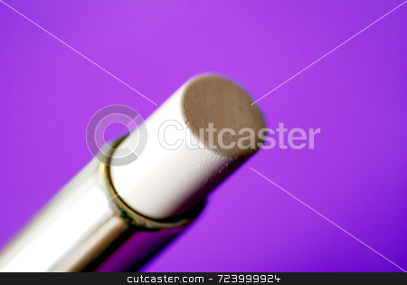 Concealer stock photo, A tube of cosmetic concealer against a purple background by Philippa Willitts