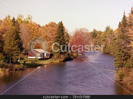 Quiet Retreat stock photo, Image of small river and cottage in Haliburton Highlands, Ontario, Canada. It was photographed in the Fall. by Ray Carpenter