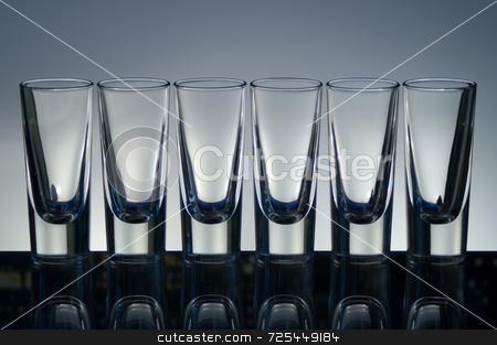 Empty vodka glasses stock photo, KONICA MINOLTA DIGITAL CAMERA by Thomas Gavagan