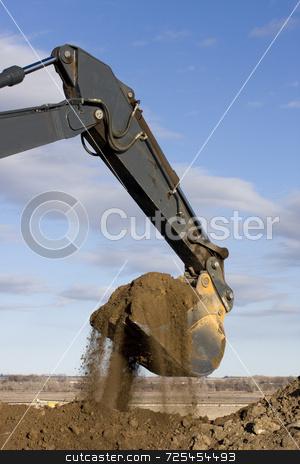 Excavator arm and scoop digging dirt at road construction stock photo, Excavator arm and scoop full of dirt at road construction against blue sky by Marek Uliasz