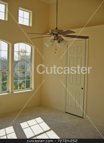 Master Bedroom stock photo, A master bedroom underconstruction with a low ceiling fan by Kevin Tietz