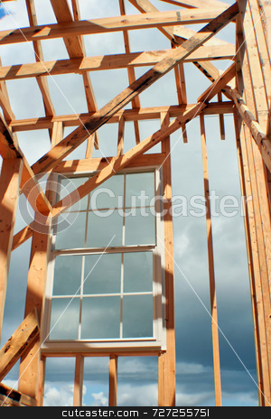 Construction Framed Window stock photo, This is a new home under construction with a window installed while its still being framed by Kevin Tietz