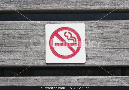 No Smoking stock photo, A no smoking sign that is on a park bench by Kevin Tietz