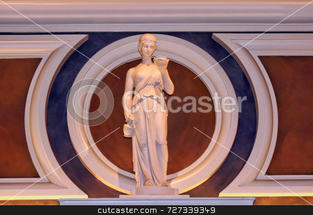 Classical Female Statue stock photo, Single classical female statue holding out her hand by Kevin Tietz