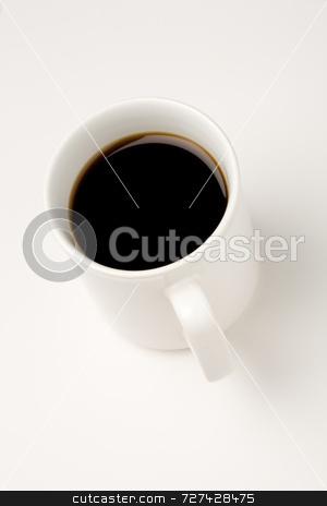 Black coffee in a white mug stock photo, Black coffee in a white mug on white background by Jon Stokes