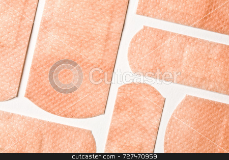 Sticking plasters stock photo, An assortment of skin colored sticking plasters by Jon Stokes