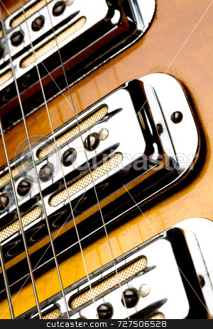 Electric guitar stock photo, Detail of pickups on an electric guitar by Jon Stokes