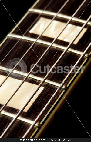 An electric guitar fretboard stock photo, An electric guitar fretboard and strings by Jon Stokes