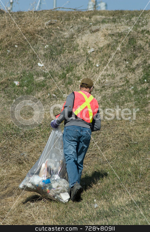 Garbage Picker stock photo, A man wearing a reflective vest, picking up spring garbage by Richard Nelson