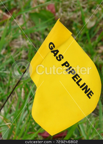 Pipeline Marker stock photo, Yellow flag marking underground natural gas line in yard. by Kathy Piper