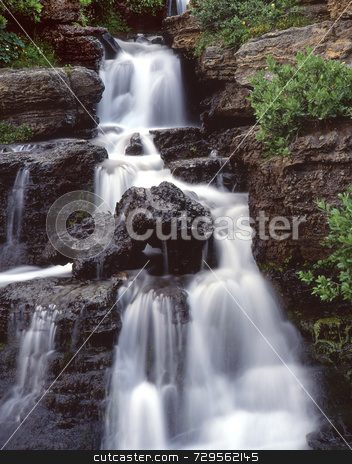 Small Water fall stock photo, A small waterfall in Glacier National Park, Montana. by Mike Norton