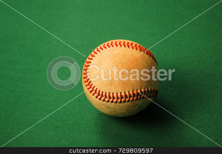 Old ball stock photo, A worn out old baseball after a season of use by Tim Markley
