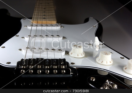 Black And White  Guitar stock photo, A black and white guitar viewed from the bridge towads the neck of the guitar by Lynn Bendickson