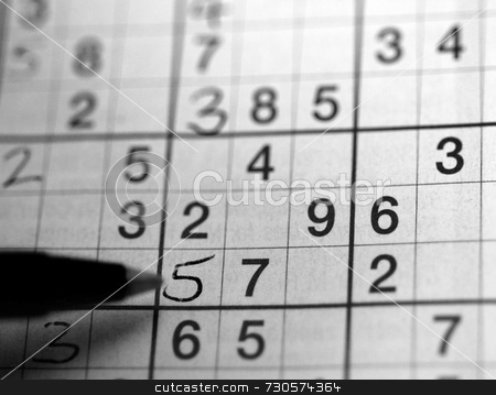 Sudoku in Black and White stock photo, Left handed person solving a su doku puzzle by Philippa Willitts
