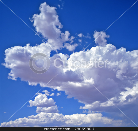 Clouds stock photo, Puffy white clouds in a blue sky. by Mike Norton