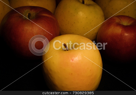 Light Painted Apples stock photo, Ripe apples in a group as a casual still life. Dark ambiance as a result of light painting the fruit. Slow shutterspeed and varyiable light source gives soft shadows and gentle highlights. by ngirl