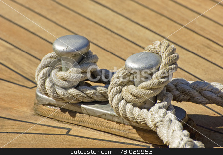 Mooring rope stock photo, Detail of a mooring rope to secure boat to dock by Massimiliano Leban
