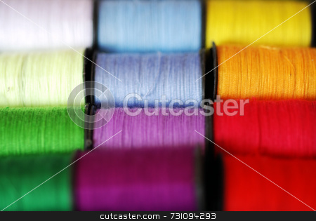 Colourful Cotton Thread stock photo, Colourful spools of bright cotton thread, in macro by Philippa Willitts