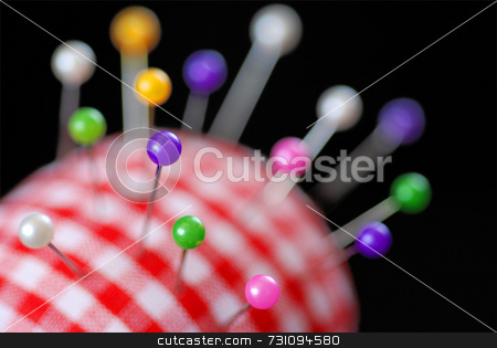 Pin Cushion stock photo, A red gingham pin cushion full of pins by Philippa Willitts