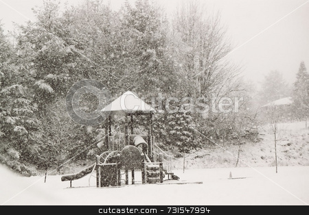 Playground in the snow stock photo, Snow in the yard after a storm by Tim Markley