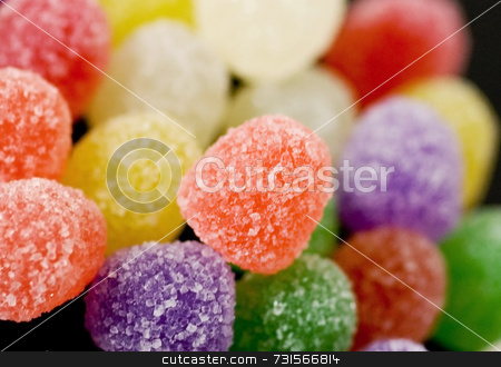 Candy Gumdrops stock photo, Pile of colorful candy gumdrops. Fine detail of sugar crystals. Main color orange with other flavors in the pile. by ngirl