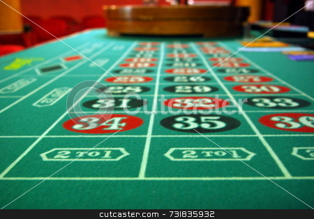 Roulette Wheel and Table stock photo, Roulette Wheel and Table by Lynn Bendickson