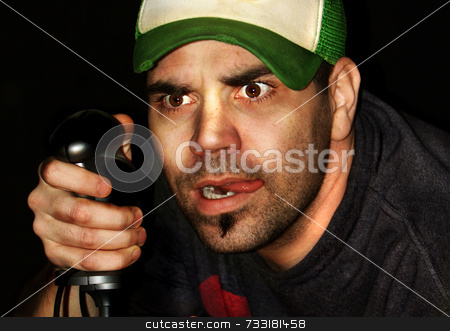 Video game player with computer joystick in his hand stock photo,  by Chris Martin