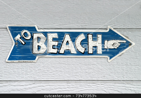 Sign To Beach stock photo, Sign with the text To Beach and a hand by Henrik Lehnerer