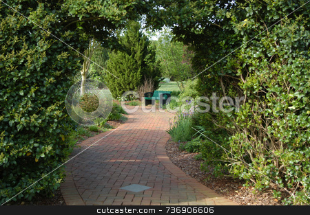 View through the grass wall stock photo, A view through the grass archawy in a formal garden by Tim Markley