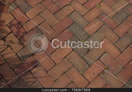 Brick walk stock photo, Closeup of a brick walkway with a crisscross pattern by Tim Markley