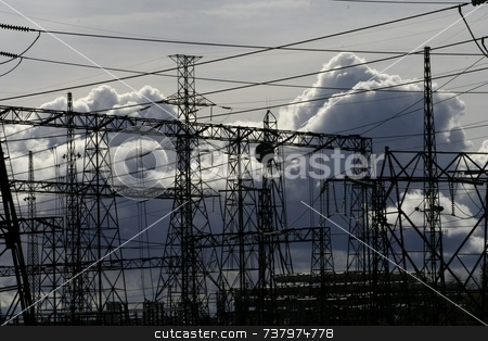 Clouds and Towers, Man Against Nature stock photo, Hydro towers with cables silhouetted against building storm clouds by Wes Shepherd
