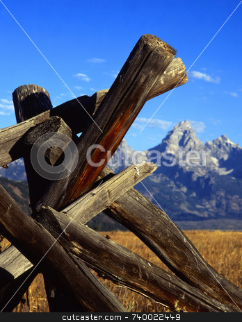 Tetons & Fence  stock photo, A buck and rail fence and the Teton Mountain Range in Grand Teton National Park, Wyoming. by Mike Norton