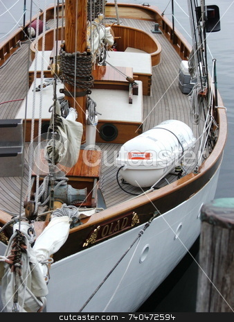 Tidy Sailboat stock photo, The Camden, Maine public docks provide a great place to view sailboats and and other watercraft.  This tidy sailboat received many appreciative looks. by Dennis Thomsen