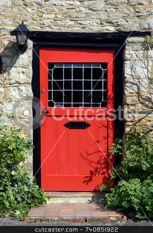 Come in stock photo, An old red door to the front of an English country cottage by Paul Phillips