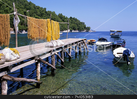 The jetty stock photo, Fishing nets drying on a jetty with fishing boats. Corfu, greece. by Paul Phillips