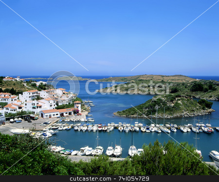 Calm stock photo, Sailboats in an inlet on the Spanish island of Minorca with villa's in the background by Paul Phillips