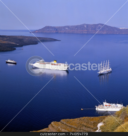 Safe harbour stock photo, Sailboats at the entrance to Santorini harbour in blue calm sea, greece, europe by Paul Phillips