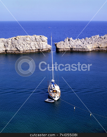 Lindos sailing stock photo, Sailboat moored off the coast of the village of Lindos on the greek island of Rhodes by Paul Phillips