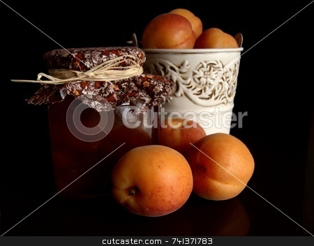 Apricot Jam Still Life stock photo, A still-life shot of home-made apricot jam, fresh apricots and a rustic tin bucket against a black background by Martie Venter
